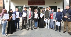 Labour's John Biggs poses outside Sir John Cass's Foundation & Red Coat Church of England Secondary School with students, staff, interim head teacher Leena Hussain and Reverend Trevor Critchlow, Chair of Governors and Rector of Stepney.