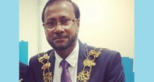 Cllr Khales Uddin Ahmed, wearing the mayoral regalia